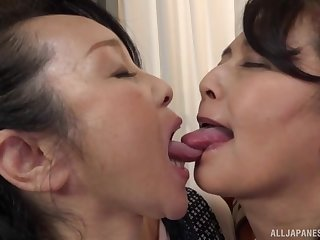 Big Japanese masture gets her pussy fingered by a lesbian lady