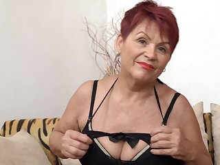Czech Granny GILF with heavy saggy bosom and shaved pussy poses solo