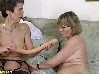 Two horny german mature in the air downcast stockings codification a Herculean dildo