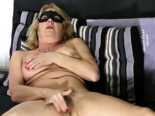 Mature fair-haired shows hairy pussy